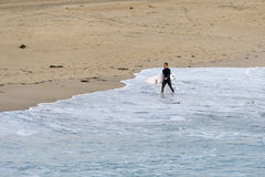 Surfer at Manhattan Beach, California Royalty Free Stock Image