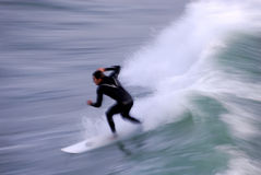 Surfer in Motion. Long exposure showing the speed and intensity of the surf and the surfer. Photo taken along the central coast of California stock photos