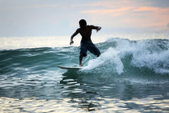 Surfer in ocean Stock Photography