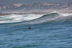 Surfer in the ocean. Summer day in Costa de Caparica, Almada, Portugal Stock Photography