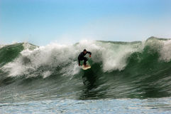 Surfer op een golf Royalty-vrije Stock Foto's
