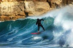 Surfer op golf Stock Fotografie