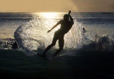 Surfer op zonsondergang Stock Afbeelding