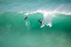 Surfer outstretched at Noordhoek Royalty Free Stock Photography