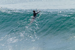 Surfer Paddle Escape Wave Royalty Free Stock Photography