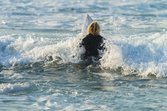 Surfer Paddle Out Stock Images
