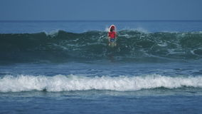 Surfer passing a wave stock footage