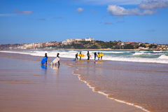 Surfer people carrying their surfboard on the beach. SANTANDER, SPAIN - AUGUST, 20: Surfer people carrying their surfboard on the beach on August 20, 2016 Stock Photo