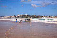 Surfer people carrying their surfboard on the beach. SANTANDER, SPAIN - AUGUST, 20: Surfer people carrying their surfboard on the beach on August 20, 2016 Royalty Free Stock Photography