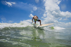 Surfer. Picture of Man Surfing a Wave royalty free stock images