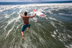 Surfer Pier Jump Mid-Air Ocean Stock Images