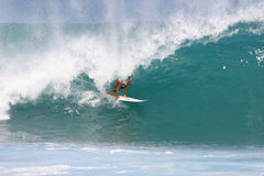 Surfer at the Pipeline. A surfer gets barrelled while surfing at Pipeline in Hawaii Royalty Free Stock Photo