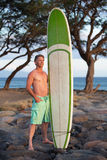 Surfer Posing with Surfboard Royalty Free Stock Images