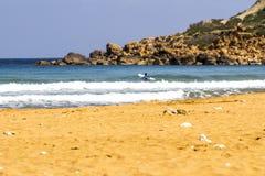 Surfer at Ramla l-Hamra Bay Gozo. Surfer trying to catch some waves at  Ramla l-Hamra Bay GOzo Stock Image