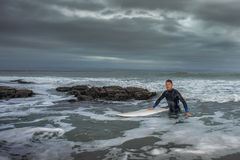 Surfer Returning from Ocean Stock Photography