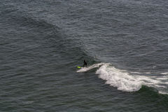 Surfer in Ribeira de Ilhas Beach in Ericeira Portugal. Stock Image