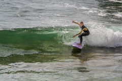 Surfer in Ribeira de Ilhas Beach in Ericeira Portugal. Royalty Free Stock Image