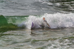 Surfer in Ribeira de Ilhas Beach in Ericeira Portugal. Stock Images
