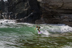 Surfer in Ribeira de Ilhas Beach in Ericeira Portugal. Royalty Free Stock Photos