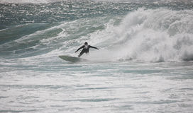 Surfer Rides A Wave Stock Photo