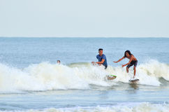 Surfer rides the back side of a wave royalty free stock images