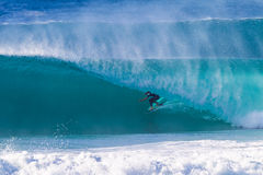Surfer Rides Hollow Wave Royalty Free Stock Images
