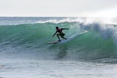 A surfer rides a point break wave at Arugam Bay in Sri Lanka. Royalty Free Stock Photos
