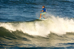 A surfer rides a wave tube II. Flagler Beach, Florida - September 21: A surfer rides a tube I on September 21, 2014. The beach is popular among surfers royalty free stock photo