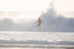 Surfer riding a big wave. Royalty Free Stock Image