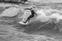Surfer Riding Brennan's Wave. Missoula, Montana: 01 July 2014 - Man surfing Brennan's Wave on the Clark Fork River royalty free stock photos