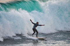 Surfer riding a 10 foot wave Royalty Free Stock Photos