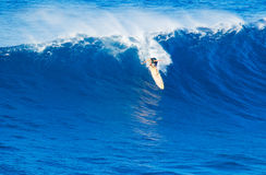 Surfer riding giant wave Royalty Free Stock Photos