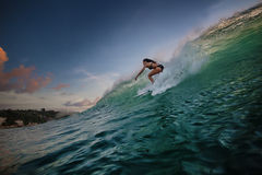 A surfer riding on green ocean wave Stock Image