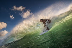 A surfer riding on green ocean wave Royalty Free Stock Images