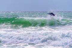 Surfer riding a huge wave Royalty Free Stock Photos