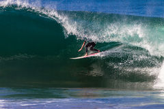 Surfer Riding Inside Hollow Wave Stock Photo
