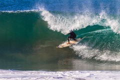 Surfer Riding Under Hollow Wave Lip Royalty Free Stock Photos