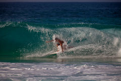 Surfer riding Royalty Free Stock Images