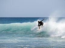 Surfer riding wave Royalty Free Stock Photography