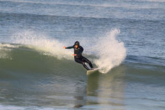 Surfer riding wave Stock Photography
