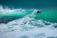 Surfer riding wave in Bali Royalty Free Stock Photo