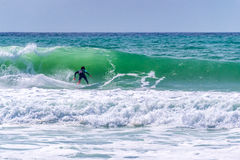 Surfer riding a wave in Lacanau, France Stock Photos
