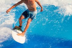 Surfer riding the waves stock photos