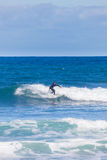Surfer riding on waves in Torquay, Australia Stock Images