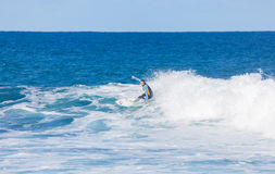 Surfer riding on waves in Torquay, Australia Stock Photography