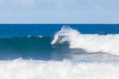 Surfer riding on waves in Torquay, Australia Royalty Free Stock Images