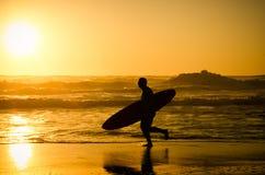Surfer running Stock Photo