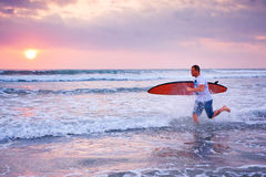 Surfer running Stock Images