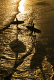Surfer`s In Silhouette On Beach Royalty Free Stock Image