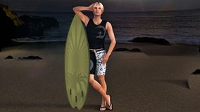 Surfer on the sea shore in the sunset. royalty free stock photo